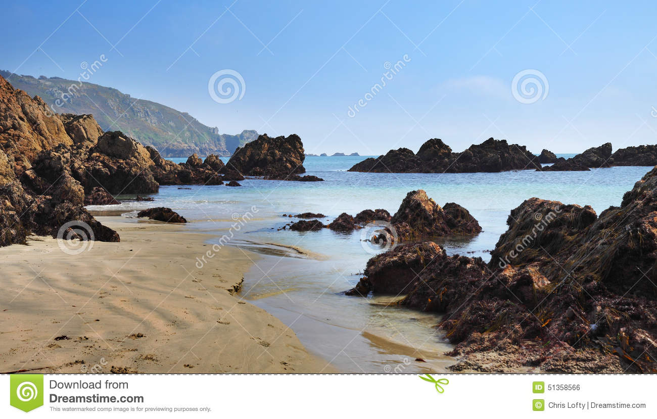 Download Peaceful Sandy Beach In Guernsey Stock Photo - Image of ocean, rocks: 51358566