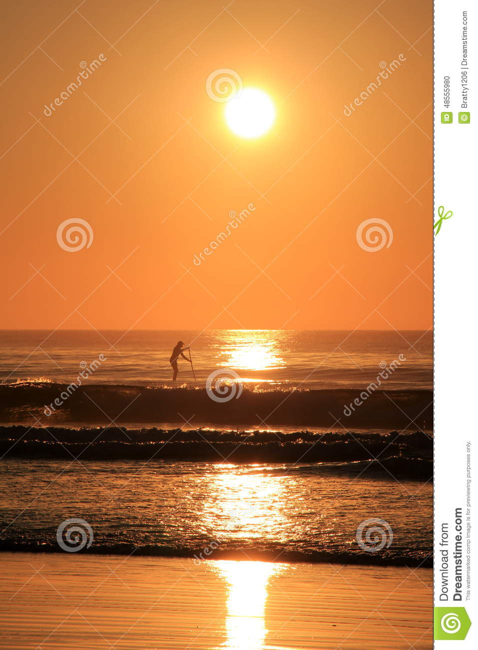 Peaceful Scene Of Early Morning And Paddle Boarder Stock Photo