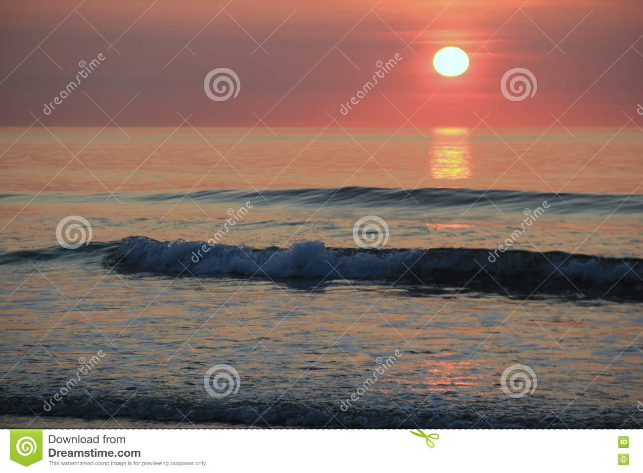 Peaceful Scene Of Early Morning Sunrise At The Beach Stock Photo