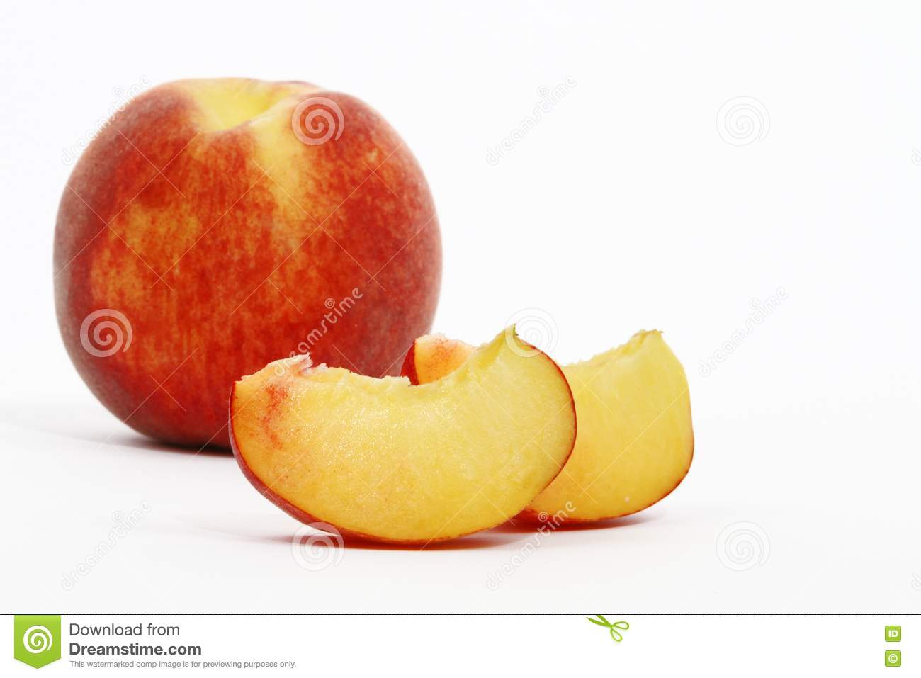 Peaches cut into wedges and whole peach