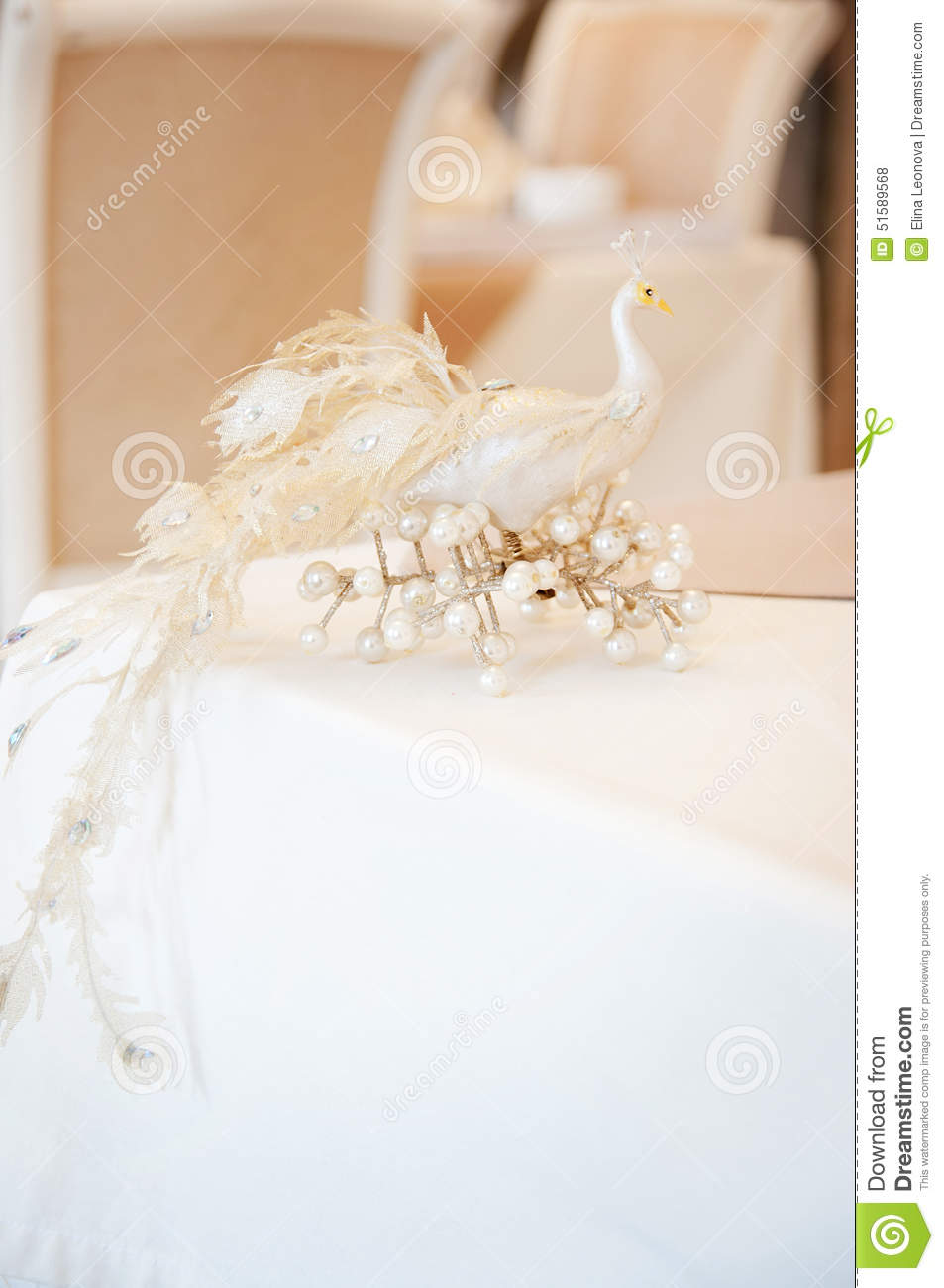 peacock, object on table in restaurant. decoration. beige stock