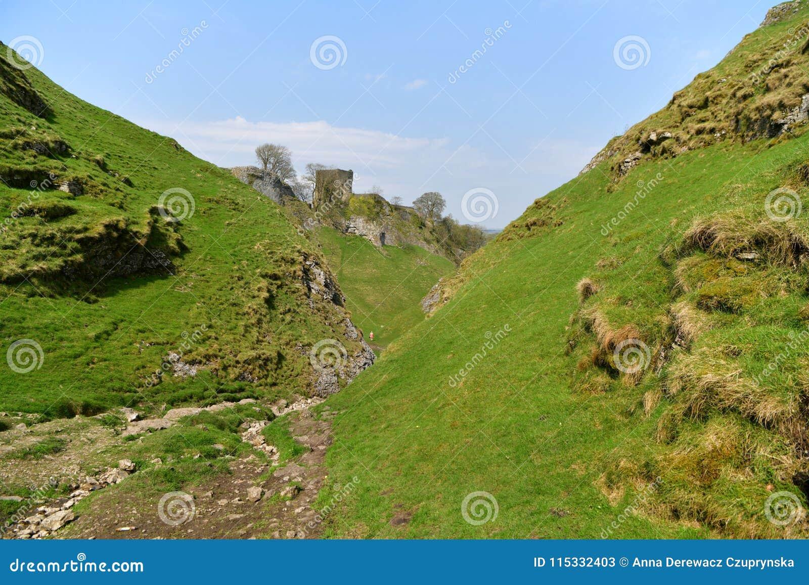 Peak District UK, old historic Peveril Castle, climb