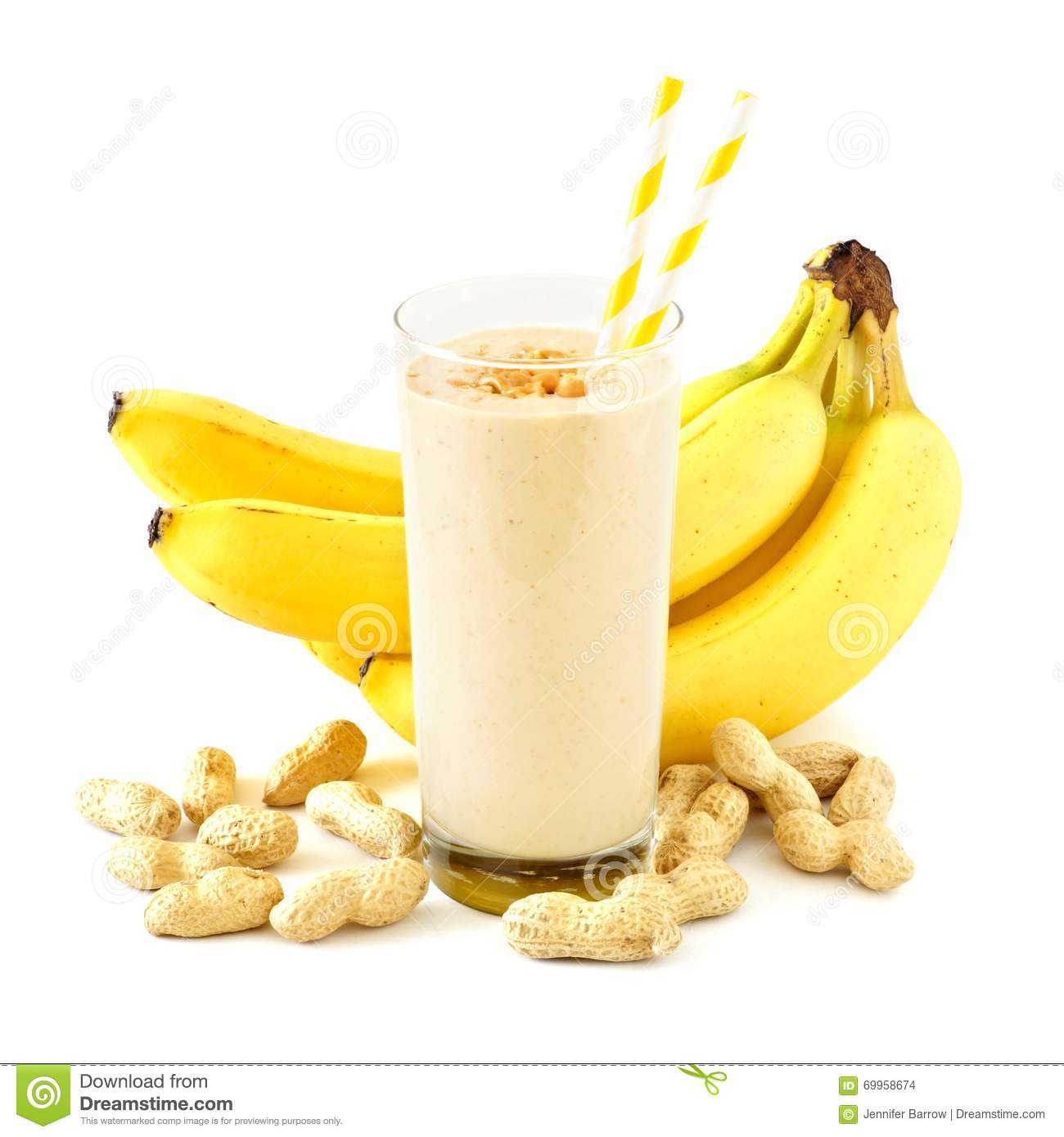Peanut-butter banana smoothie with scattered ingredients over white