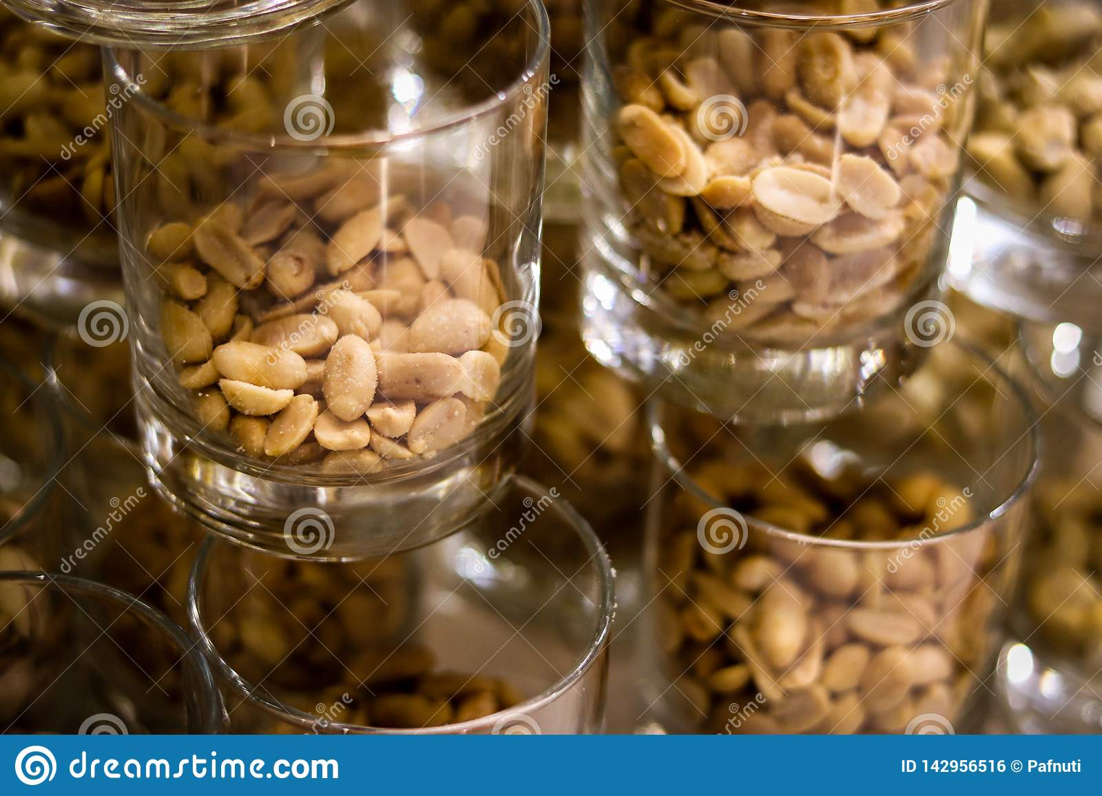 Peanuts in the glass on dark background