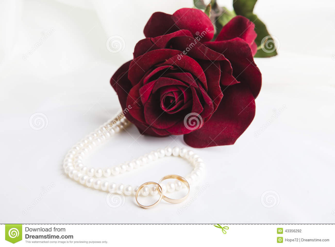 Pearl Heart, A Rose And Wedding Rings Stock Photo - Image of roses ...