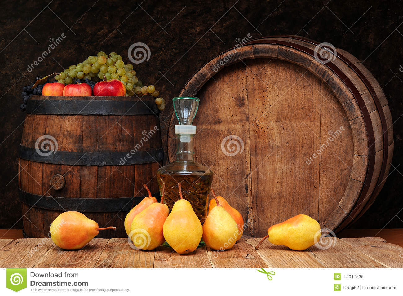 Pears, wooden barrel and the brandy bottle