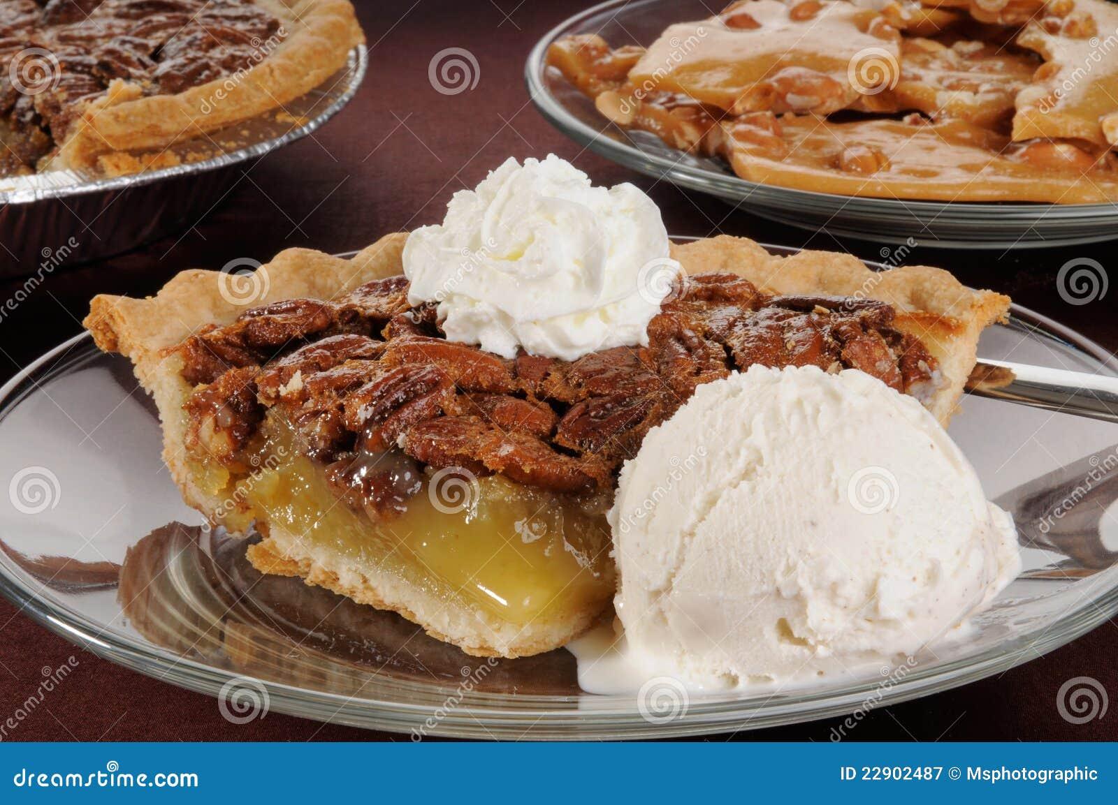 Pecan pie with ice cream stock image. Image of golden ...