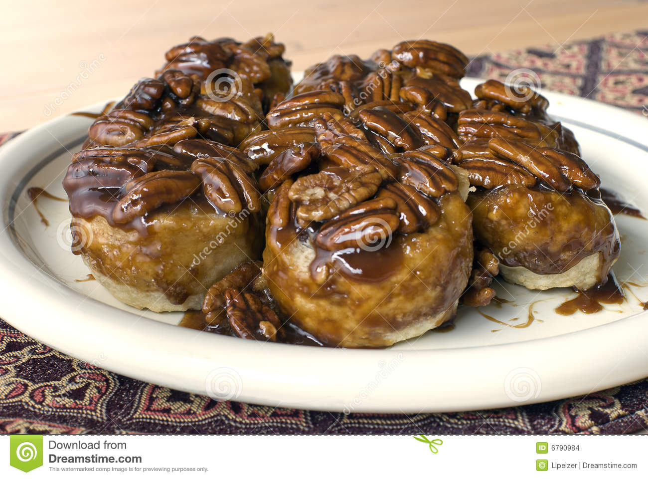 Plate full of homemade cinnamon pecan sticky buns.