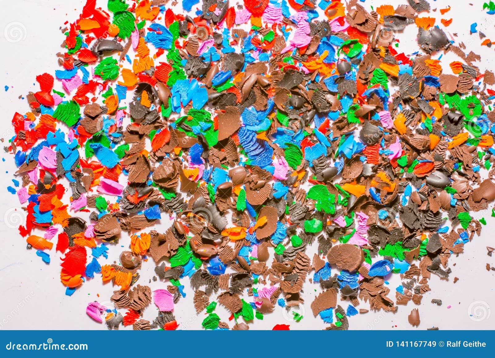 Pedazos coloridos de la cera de las extremidades