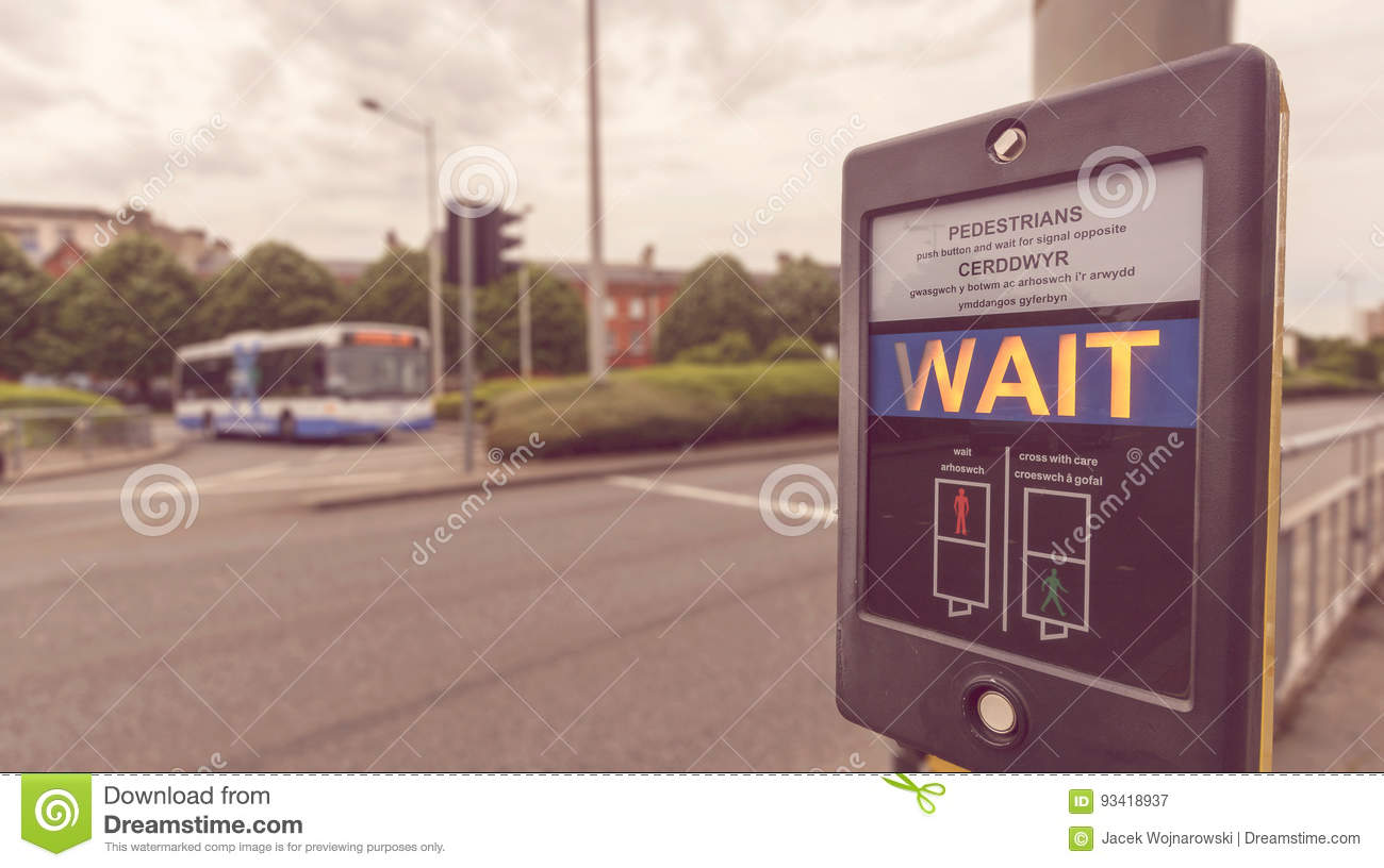 Pedestrian Wait Sign at Pelican crossing in both English and Welsh languages B
