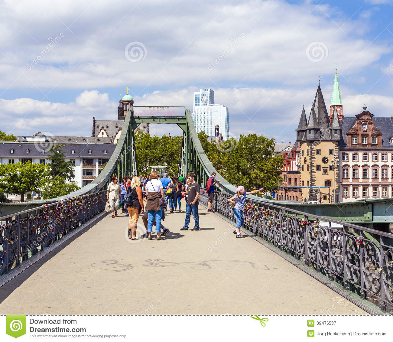 pedestrians on the bridge eiserner steg in frankfurt am main germany editorial photography. Black Bedroom Furniture Sets. Home Design Ideas