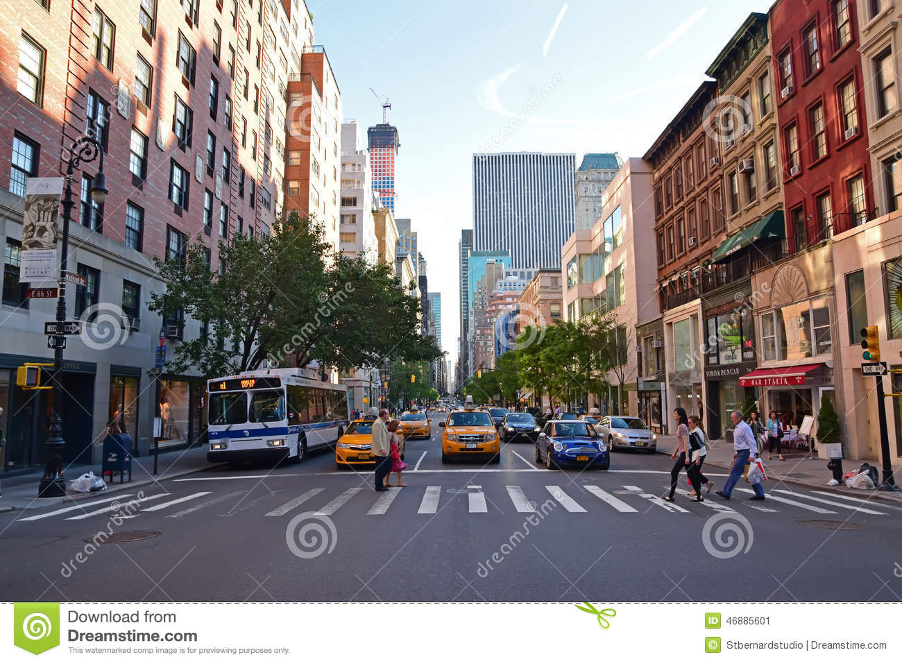 pedestrians crossing on a zebra crossing along madison avenue new york city editorial photo. Black Bedroom Furniture Sets. Home Design Ideas