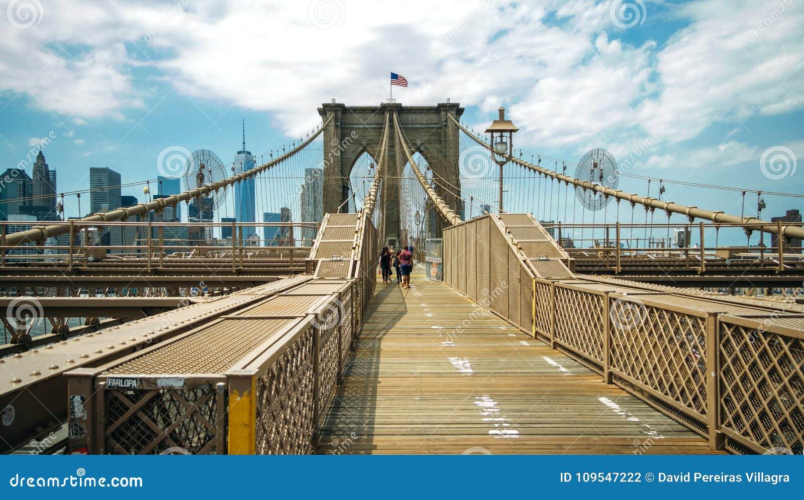 Pedestrians Walking By Brooklyn Bridge In New York City Editorial