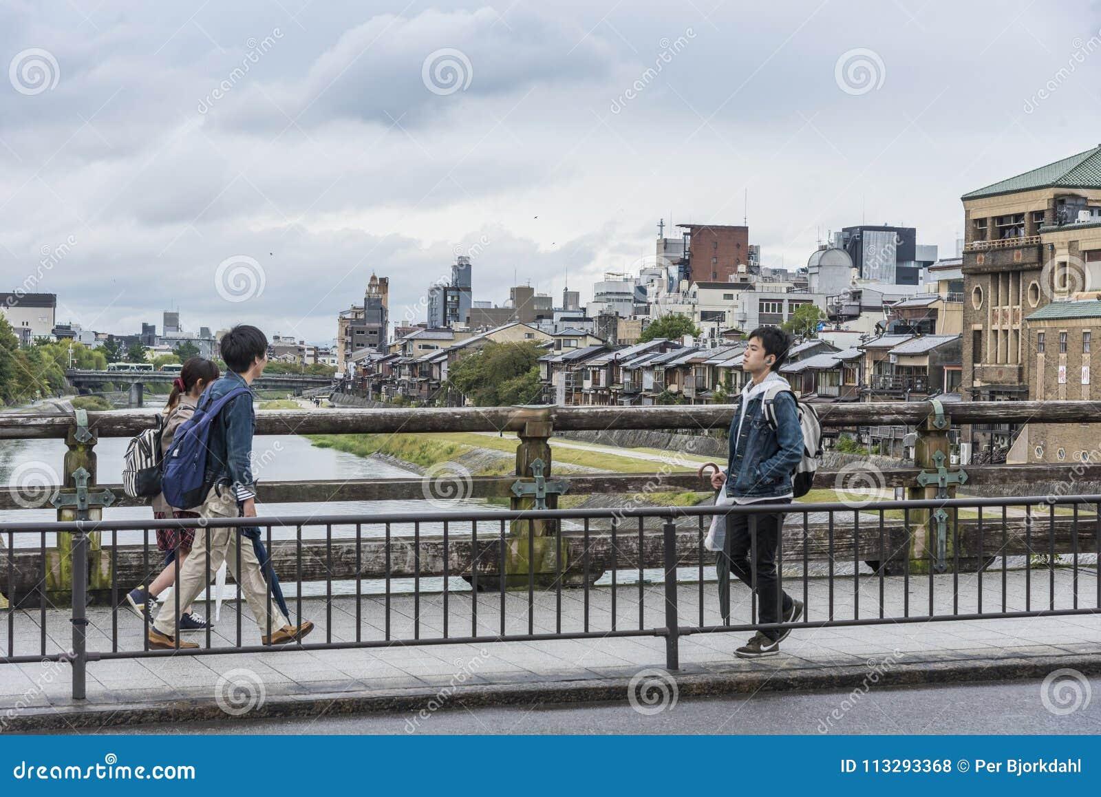 Pedestrians Sanjo dori bridge Kyoto Japan
