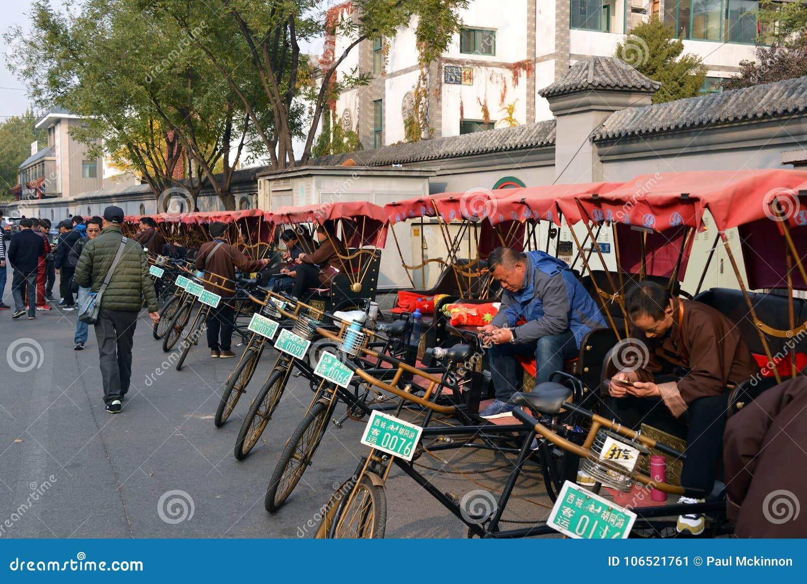 Pedicab riders wait for passengers