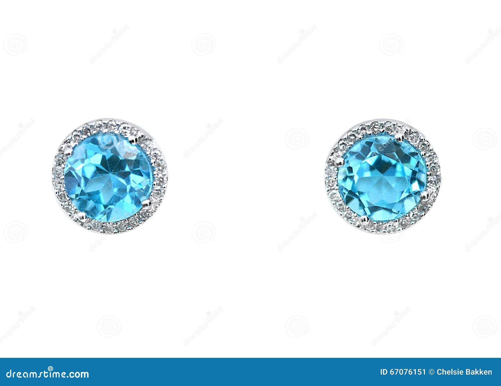 42df6ac4b0a A pedra preciosa do topázio e o coxim azuis dos brincos do diamante  cortaram com um
