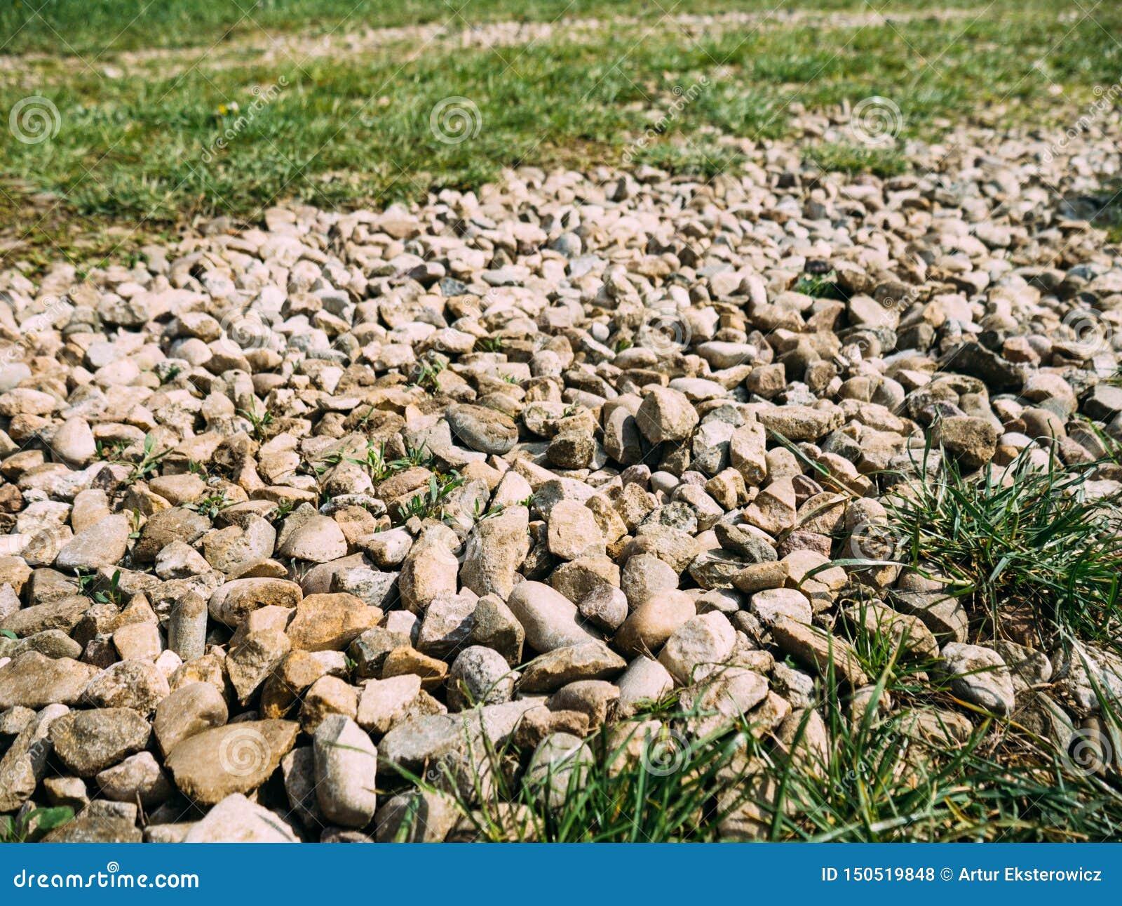 Pedras no minério da estrada