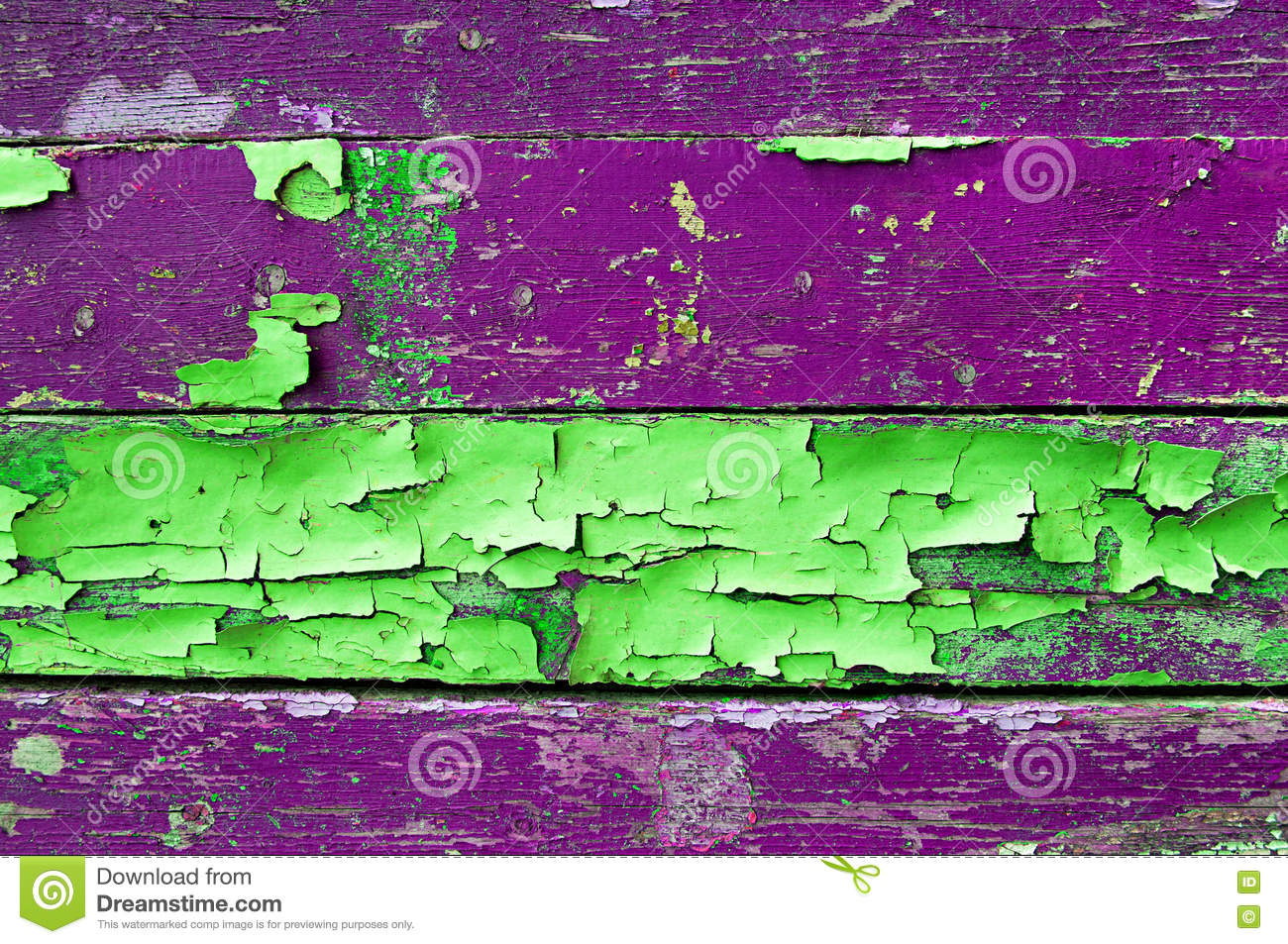 Peeling paint on old weathered wood with peeling paint of green and violet colors- textured wooden background