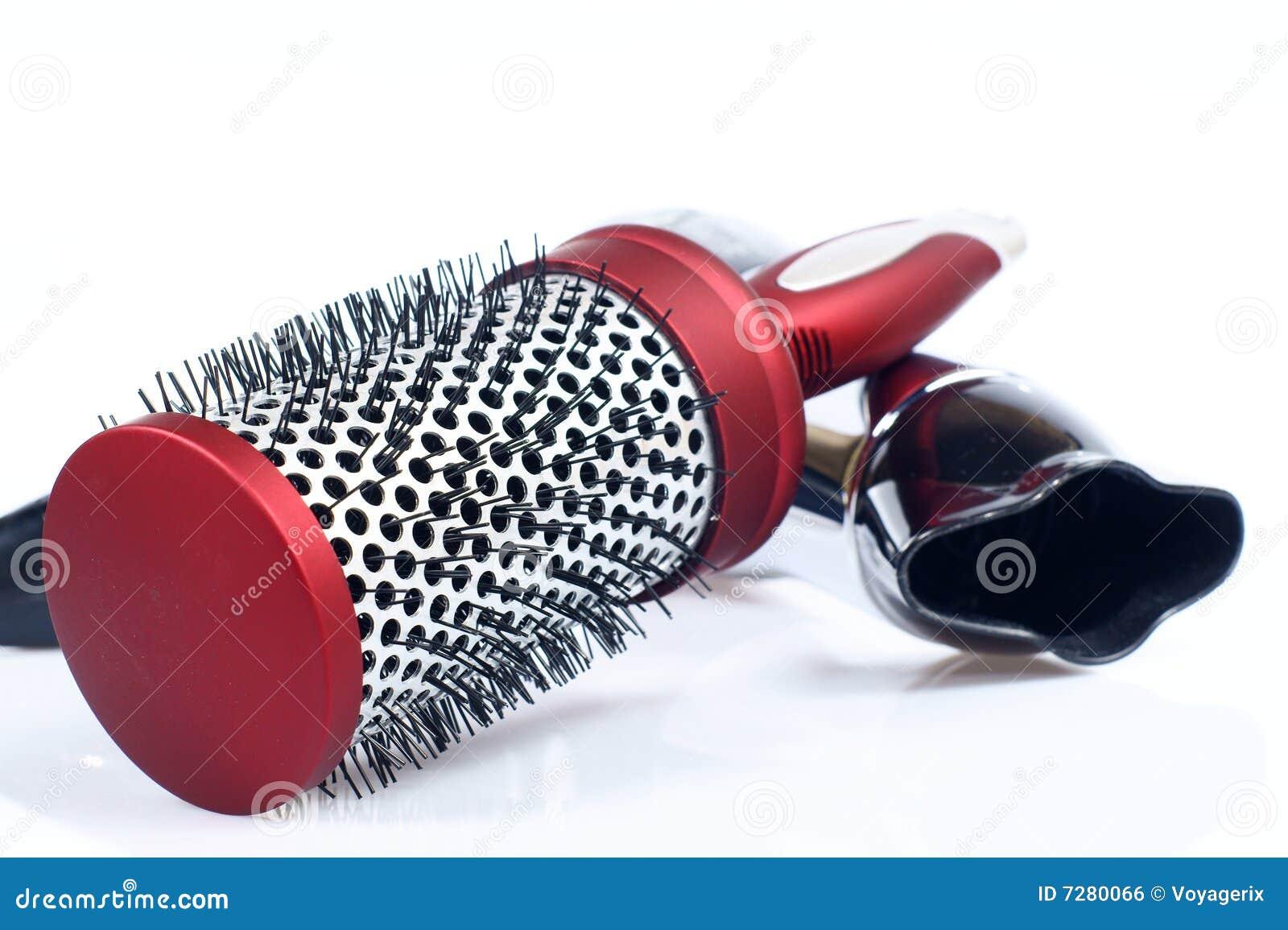 Peine y hairdryer redondos rojos