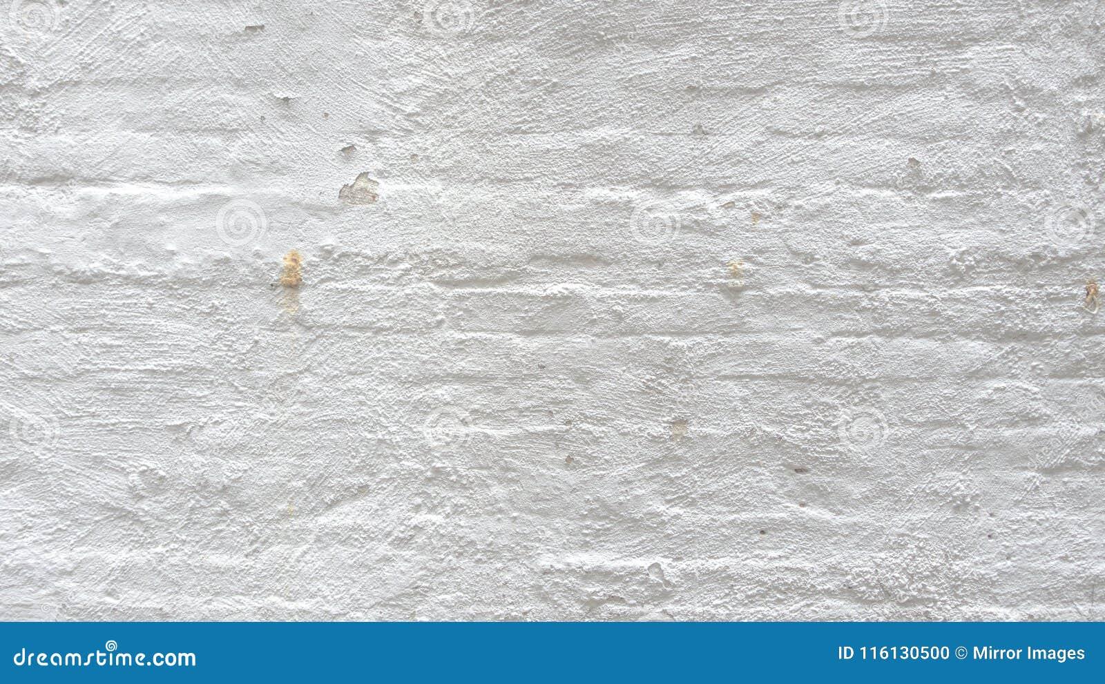 Peinture Blanche Sur Le Mur De Briques Exposé Par Intérieur