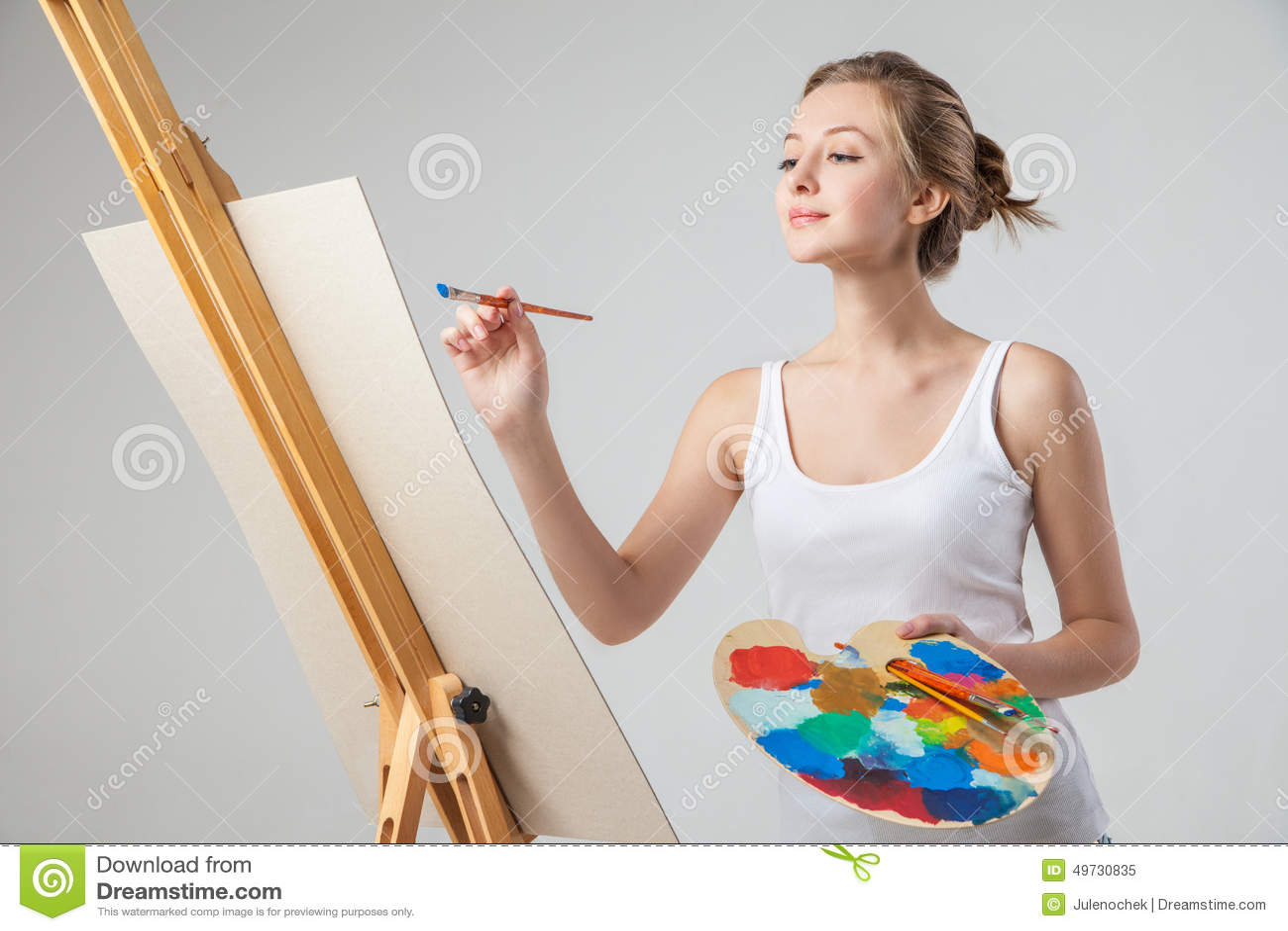 peintures de fille sur la toile avec des couleurs l 39 huile au dessus de blanc image stock. Black Bedroom Furniture Sets. Home Design Ideas