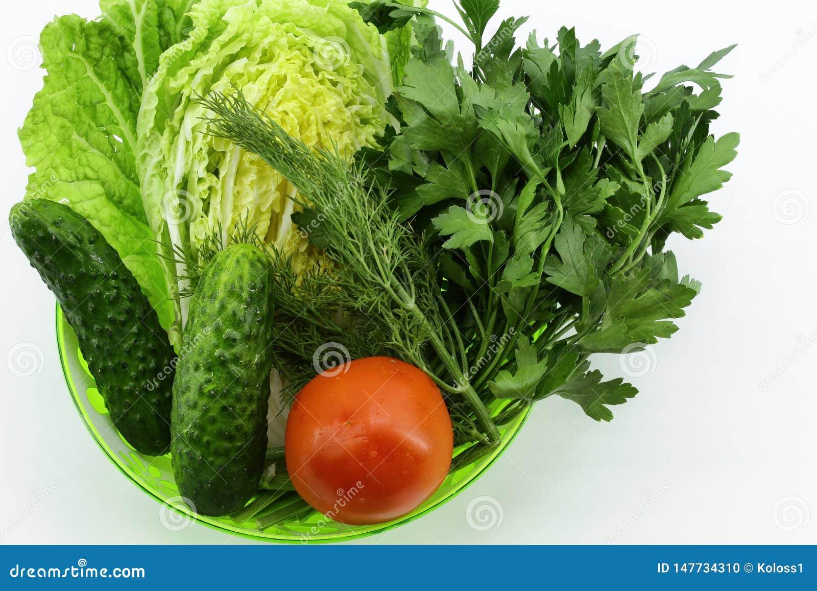 Vegetable set in deep green bowl on light background