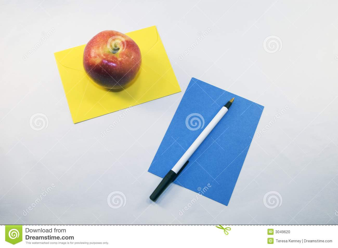 Pen and apple on paper