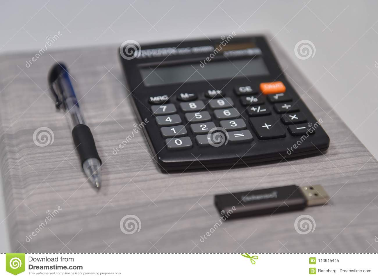 Pen, calculator and usb stick in the office