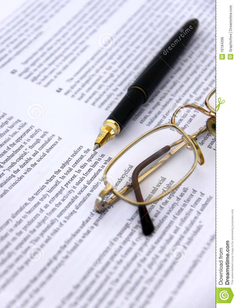 Pen and Eyeglasses on a document closeup