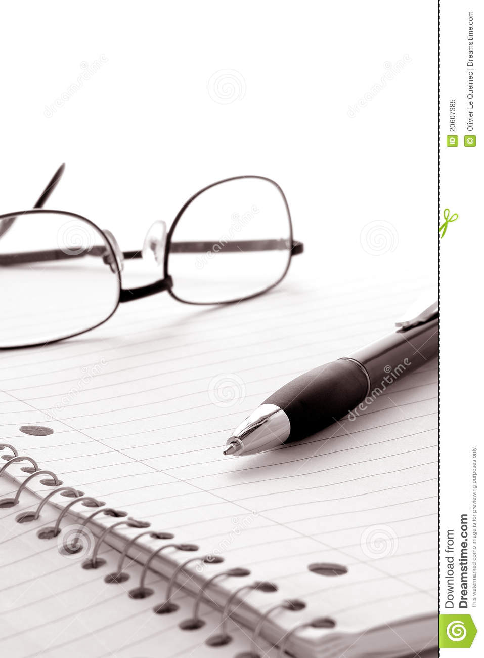 pen and glasses on notebook blank paper sheet stock image
