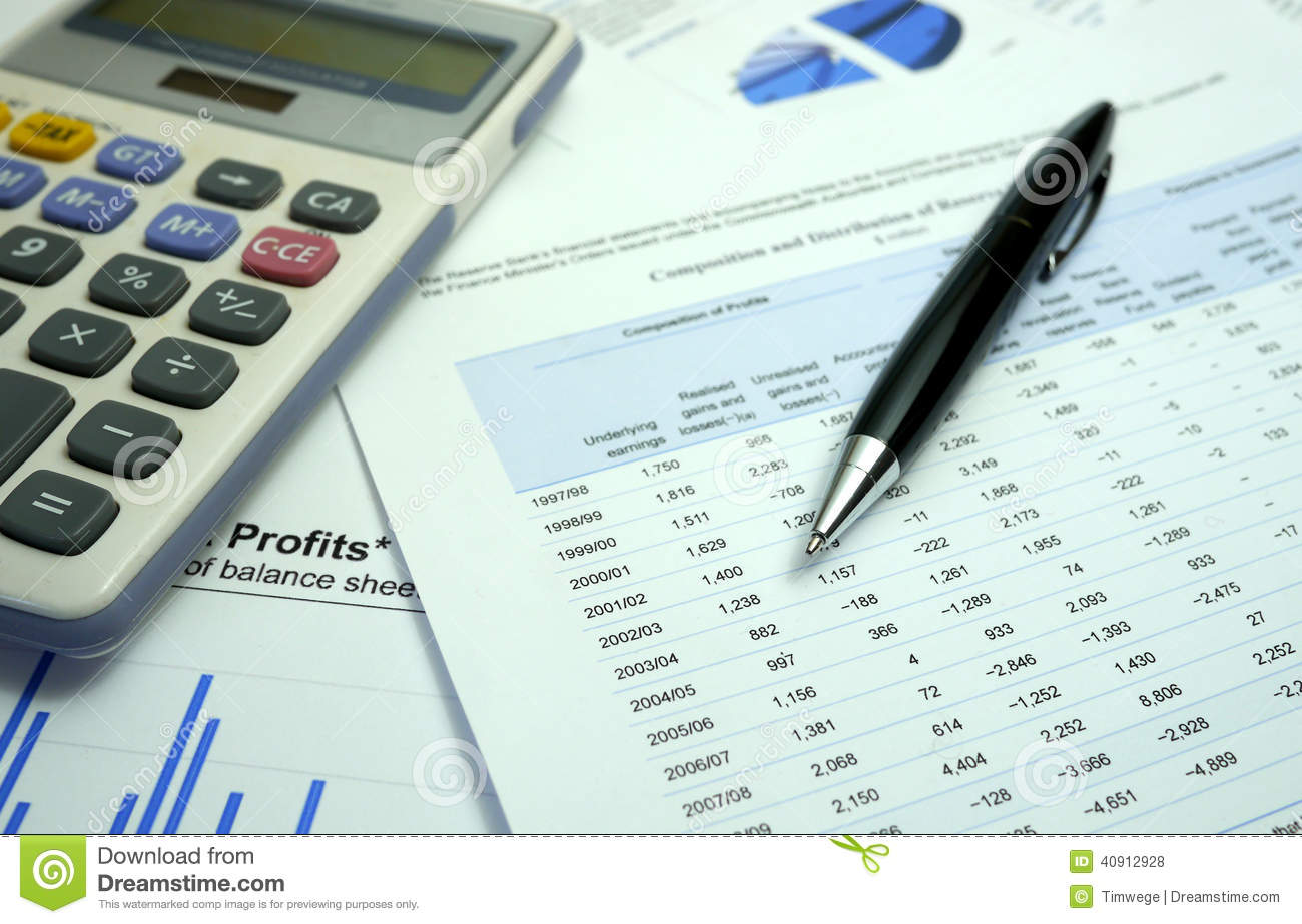 Pen and graph on financial documents with calculator
