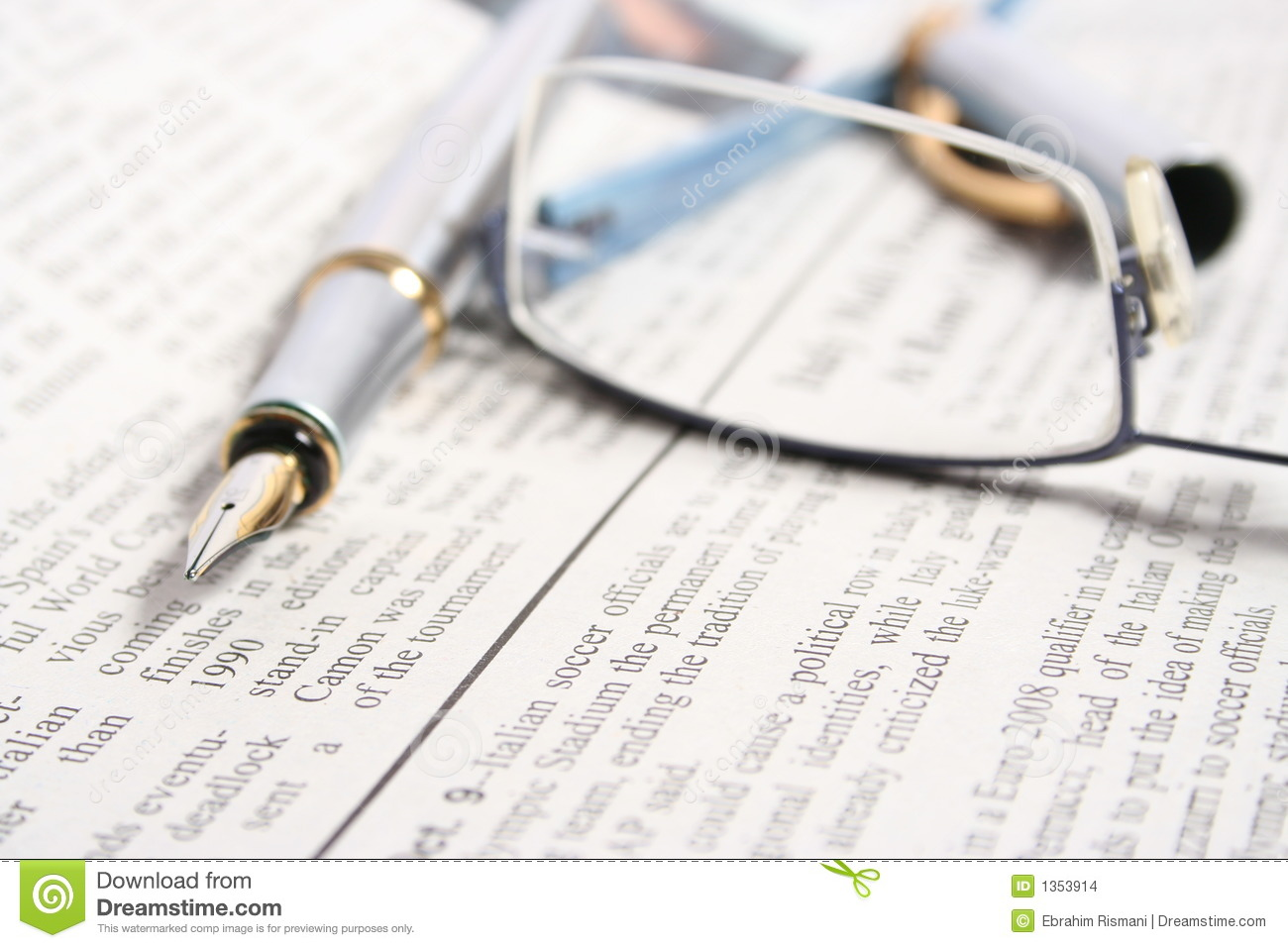 PEN ON NEWSPAPER WITH GLASSES Stock Image