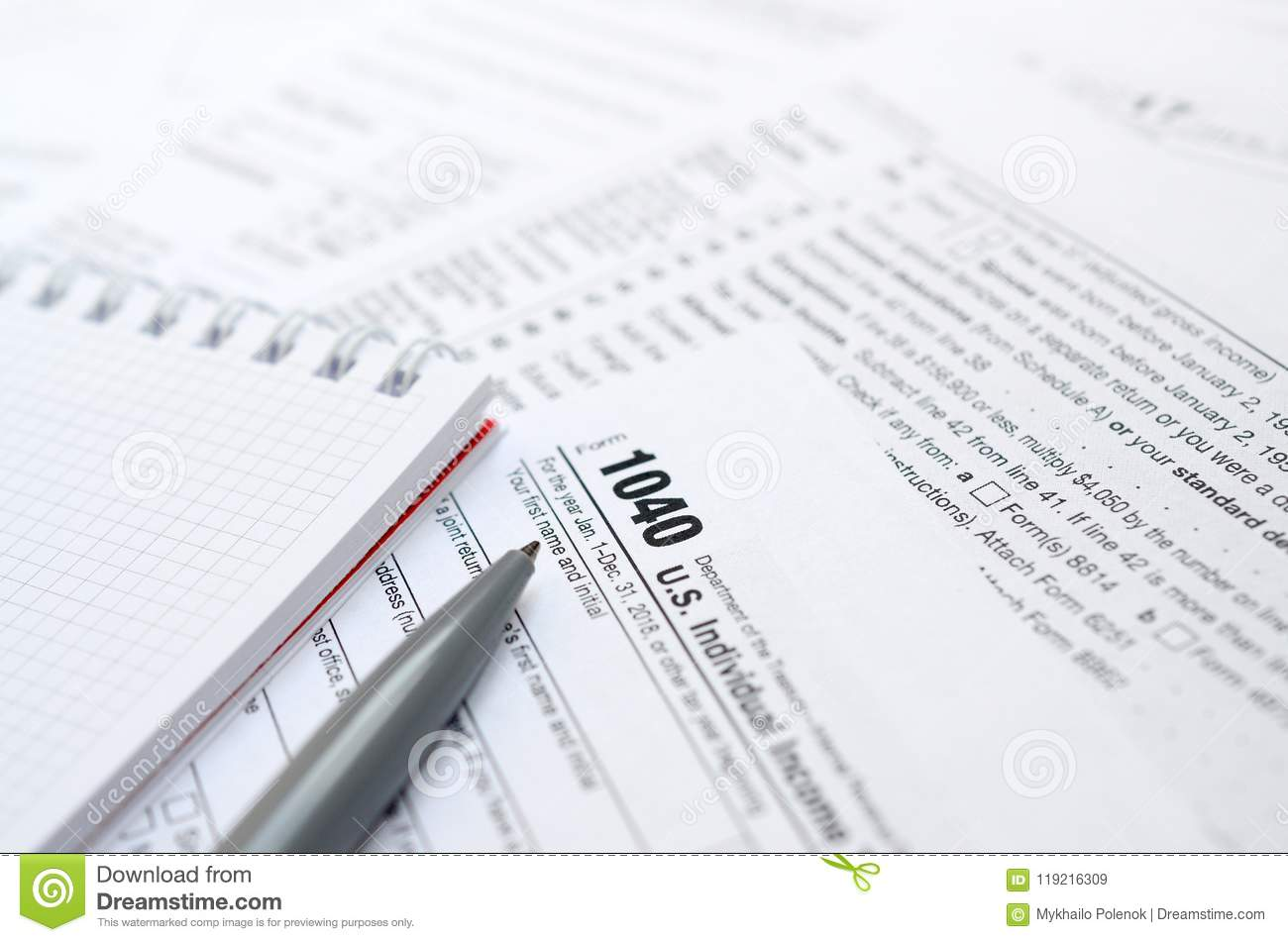 The Pen And Notebook Is Lies On The Tax Form 1040 Us Individua