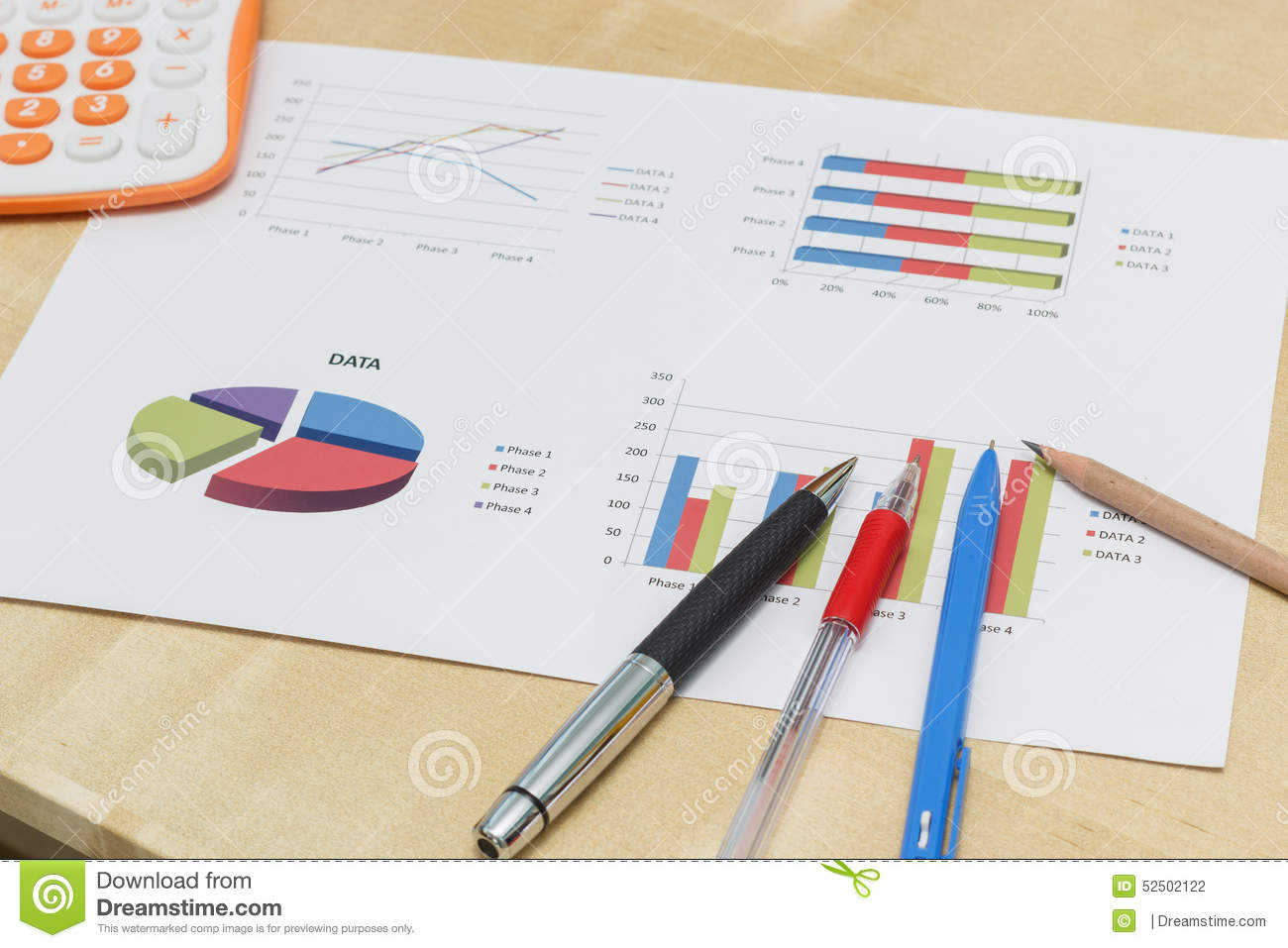 Pen And Pencil On Business Graph With Calculator  Stock Photo