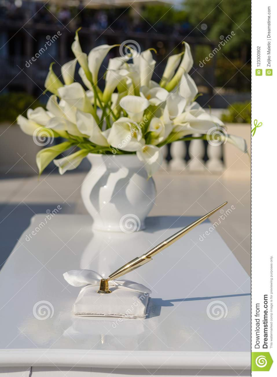 Pen On White Table With Flower Bouquet Stock Photo - Image of holder ...