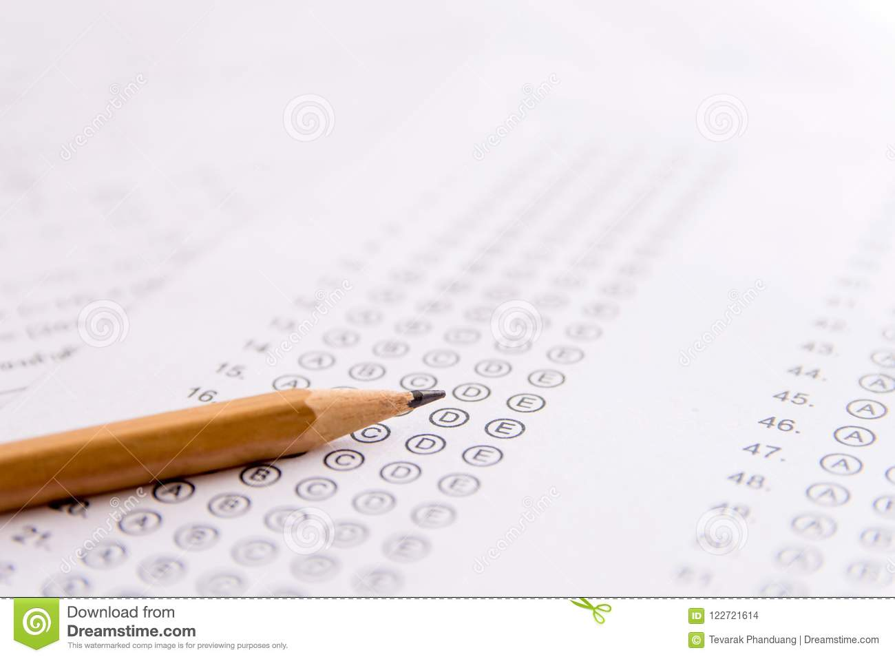 Pencil on answer sheets or Standardized test form with answers b