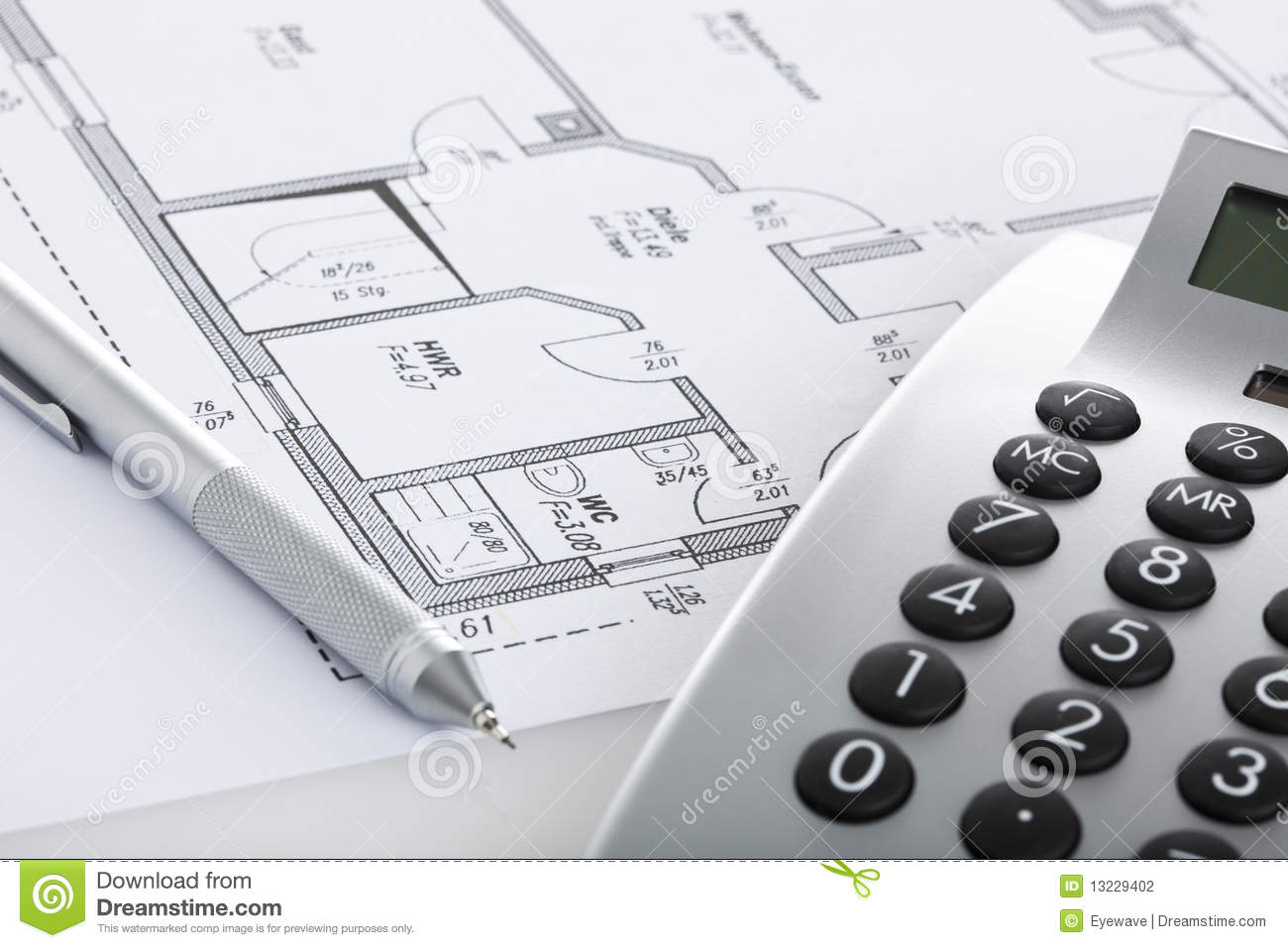 pencil and calculator on blueprint of floor plan stock