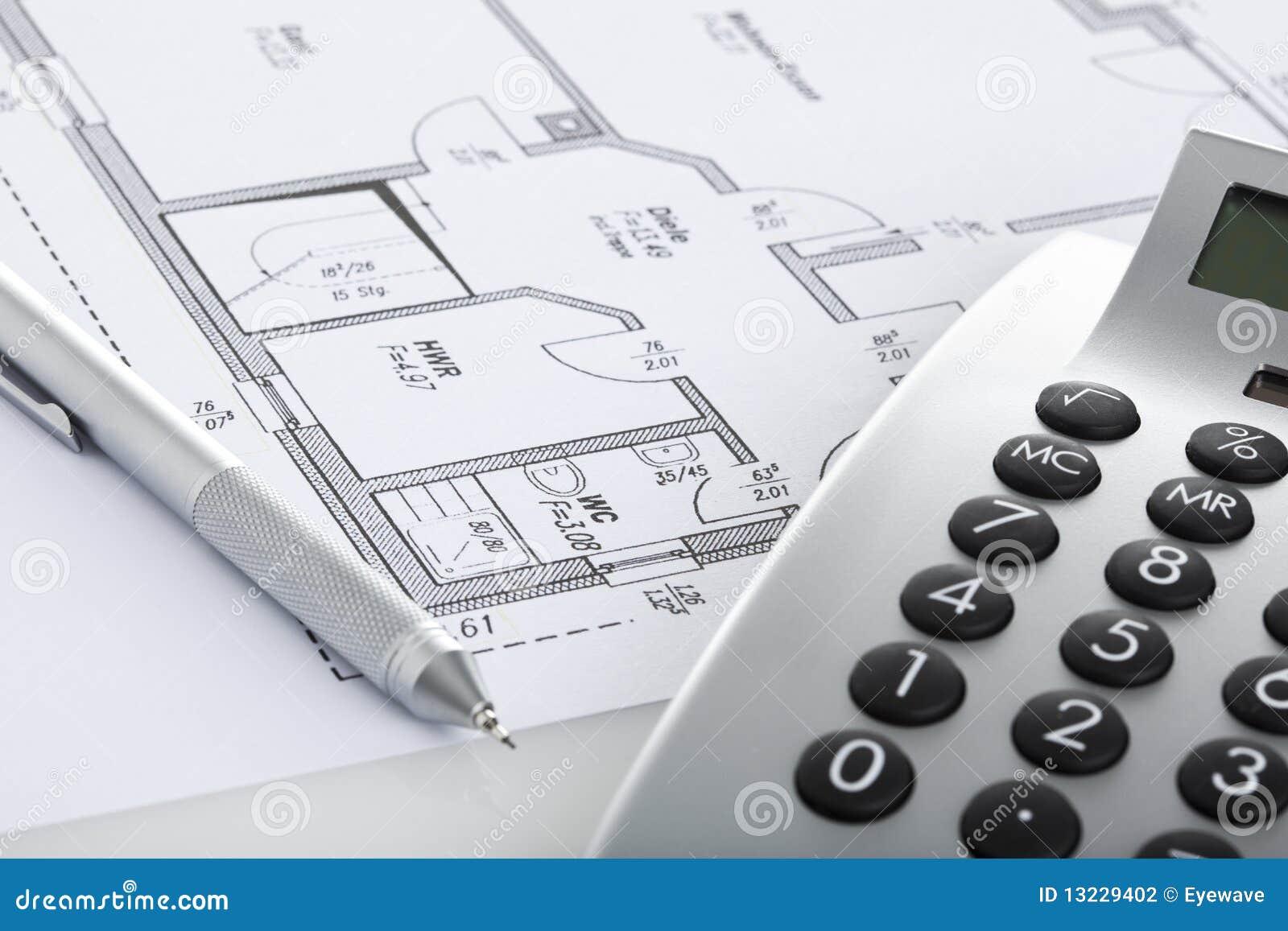 Pencil And Calculator On Blueprint Of Floor Plan Stock