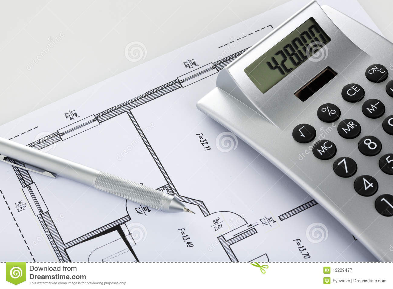 Pencil And Calculator On Blueprint Of Floor Plan Royalty