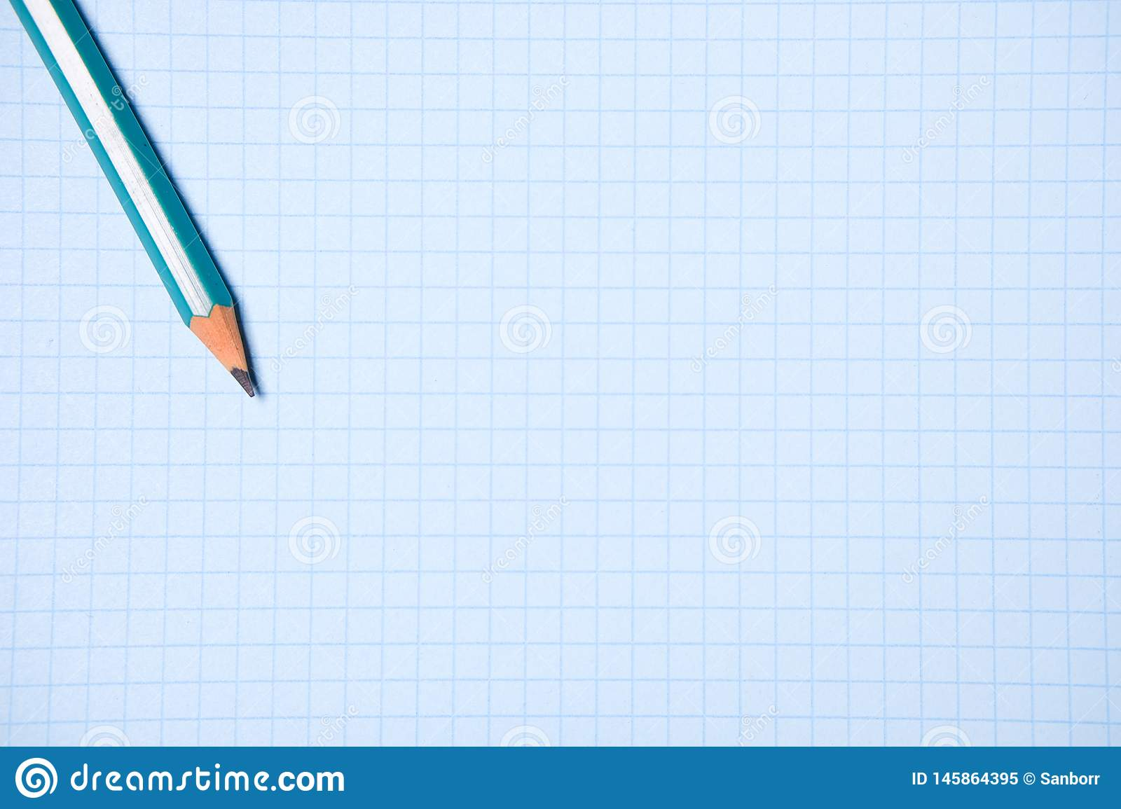 Pencil on a clean white paper sheet. The concept of education, business, entrepreneurship. Copy space