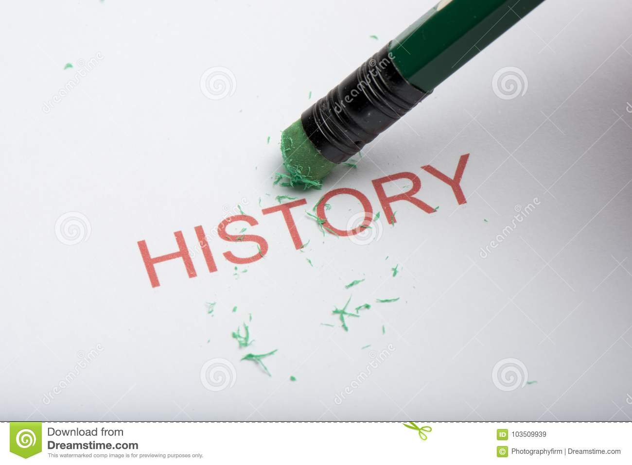 Pencil Erasing the Word `History` on Paper