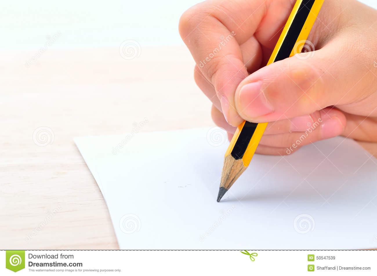 hand writing on paper Grip the pencil like you would when you sit down to write a letter- between your   instead, you want to move both your hand and forearm when you draw as this.