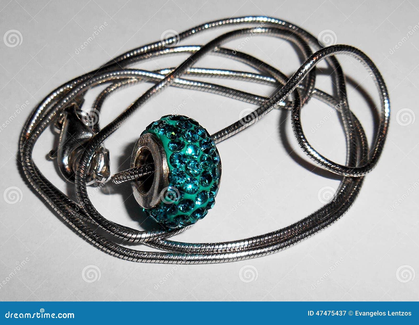 Pendant with precious crystals