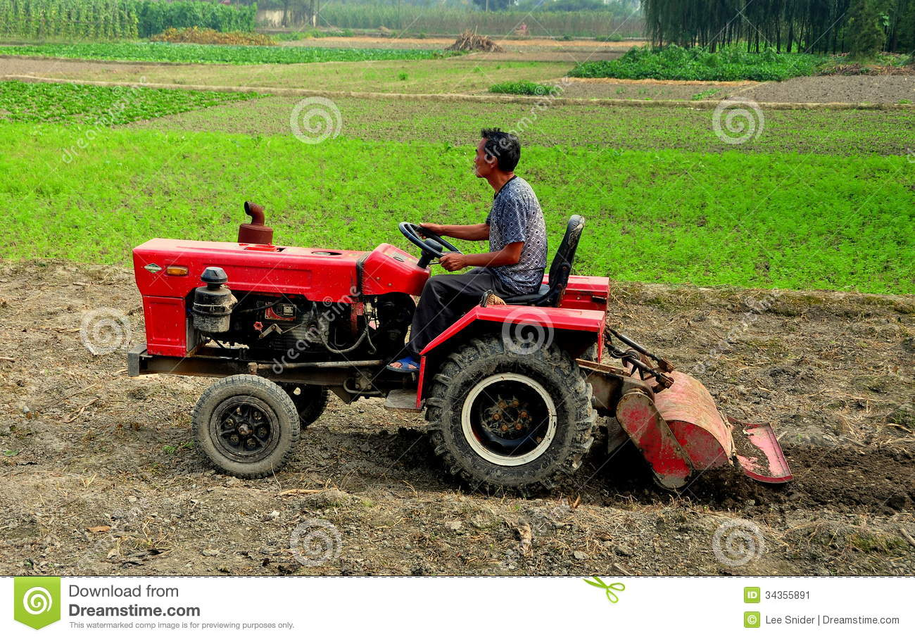 Pengzhou, China: Farmer Plowing Field With Tractor ...