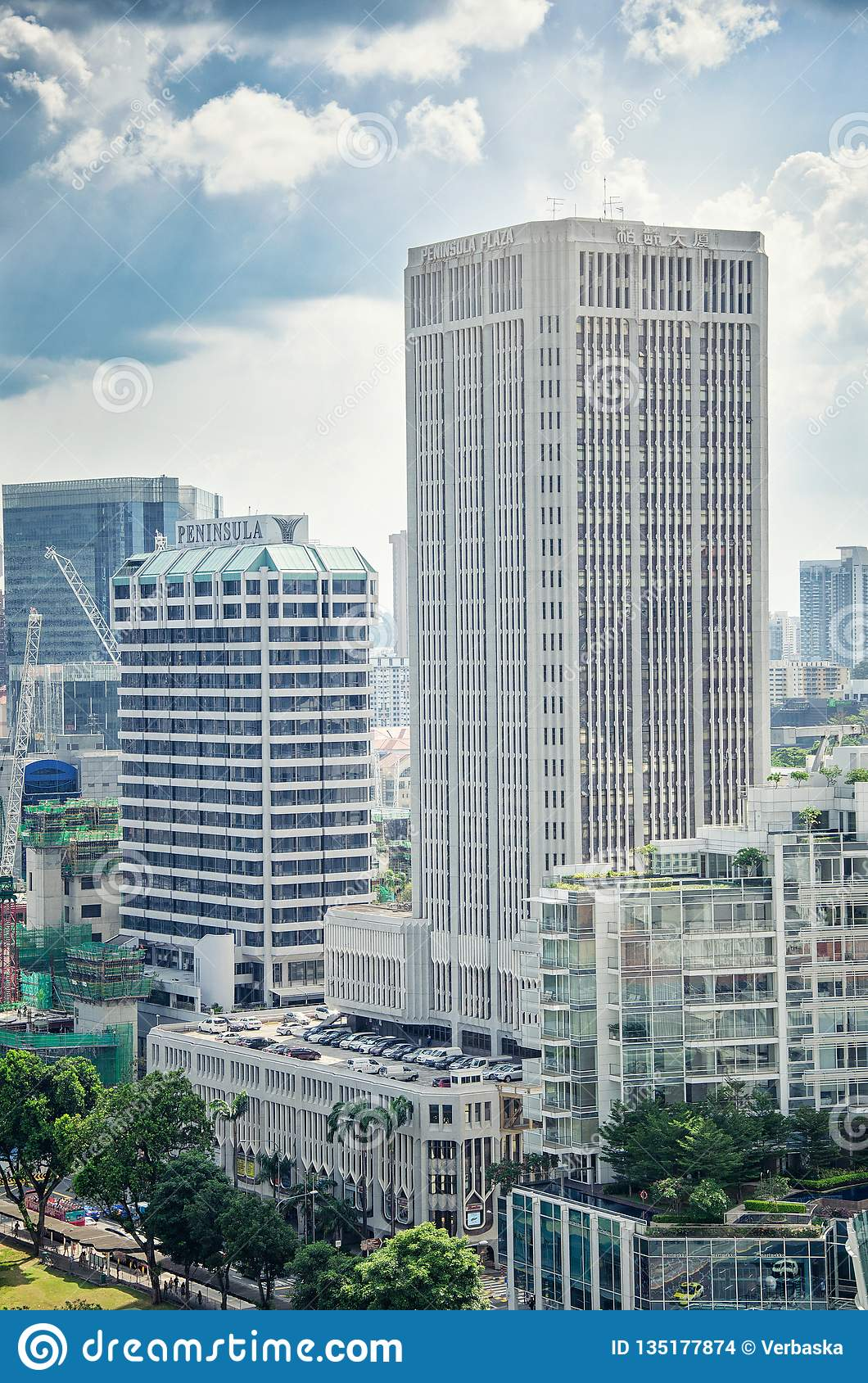 Tall square rectangular of Peninsula Plaza 30-floor tower distinguishes from other towers by its external grey ribs.