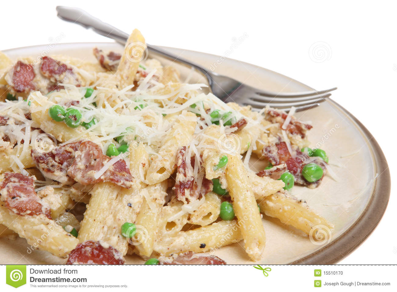 Rigatoni pasta with pancetta, ricotta and peas. Garnished with grated ...