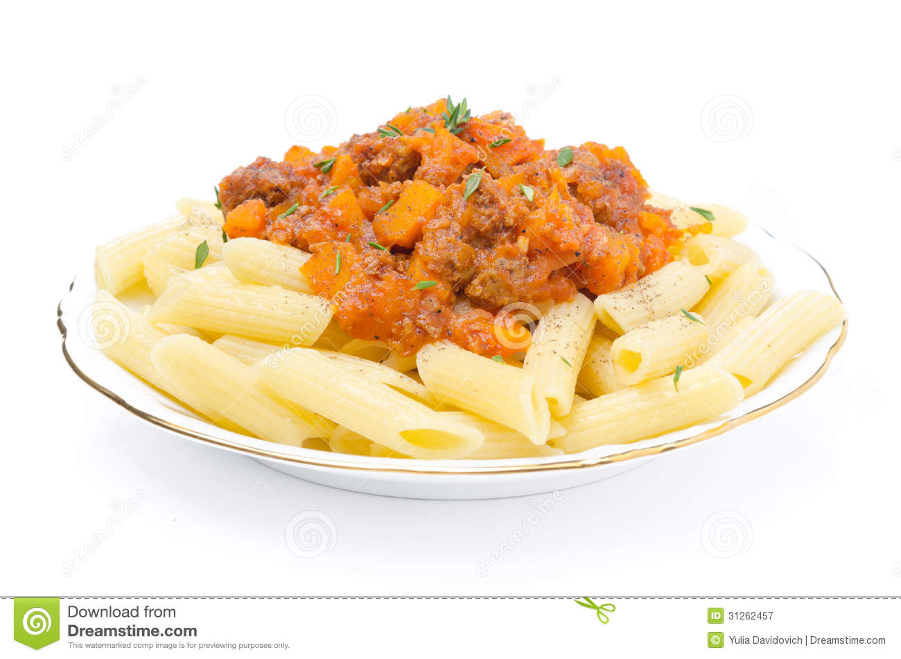 Penne pasta with sauce of beef, tomato and pumpkin on a plate isolated ...