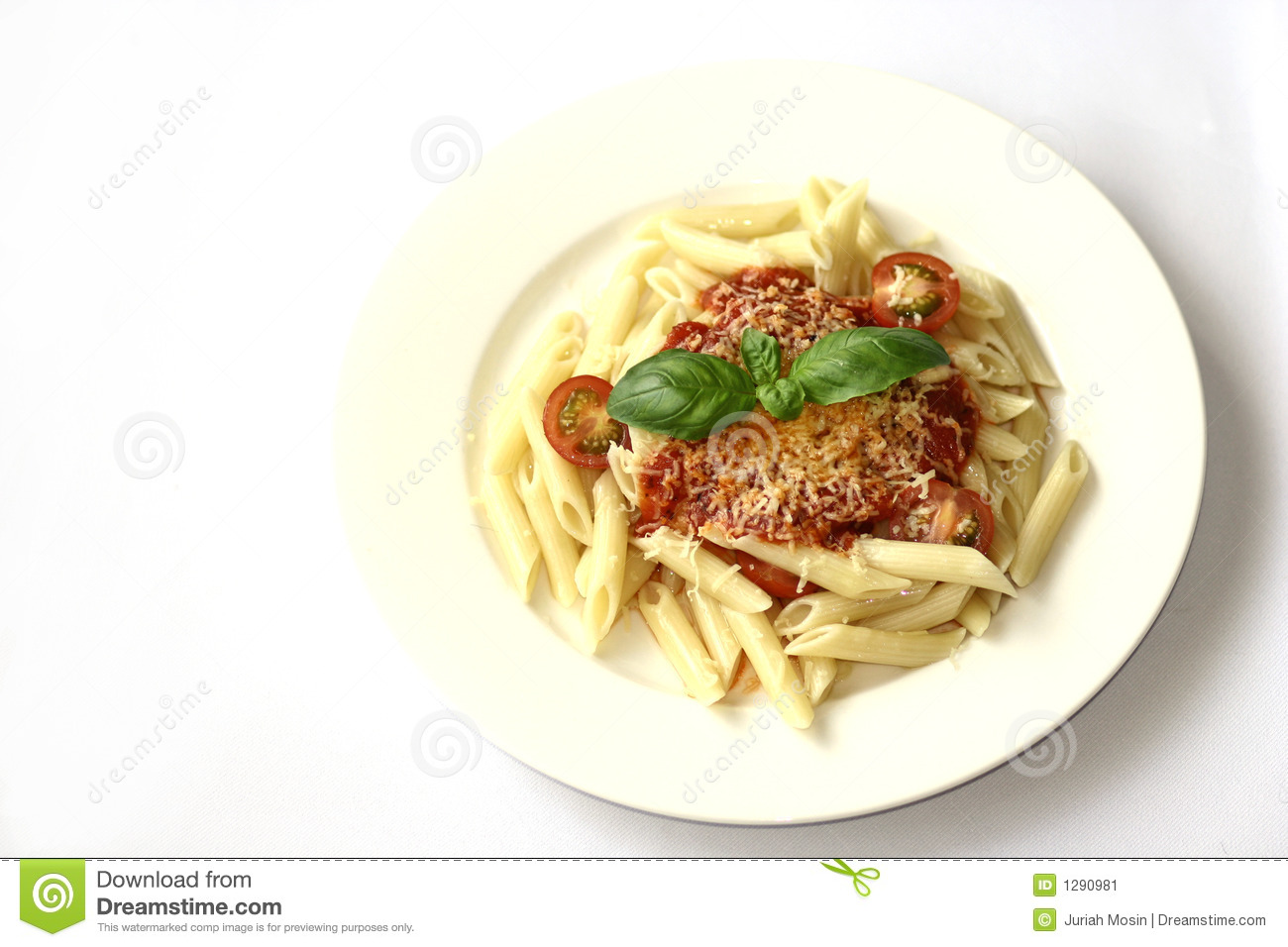 Plate of penne pasta with tomato sauce and sprinkling of cheese ...