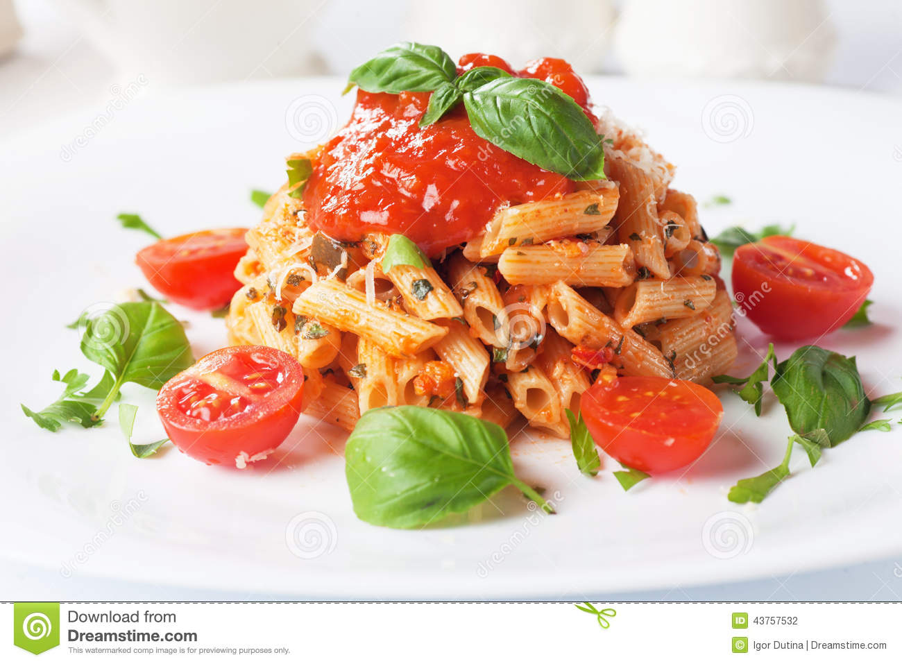 ... rigate pasta with tomato sauce, grated parmesan cheese and basil
