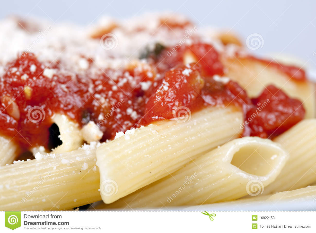 Pasta with tomato sauce and grated parmesan.